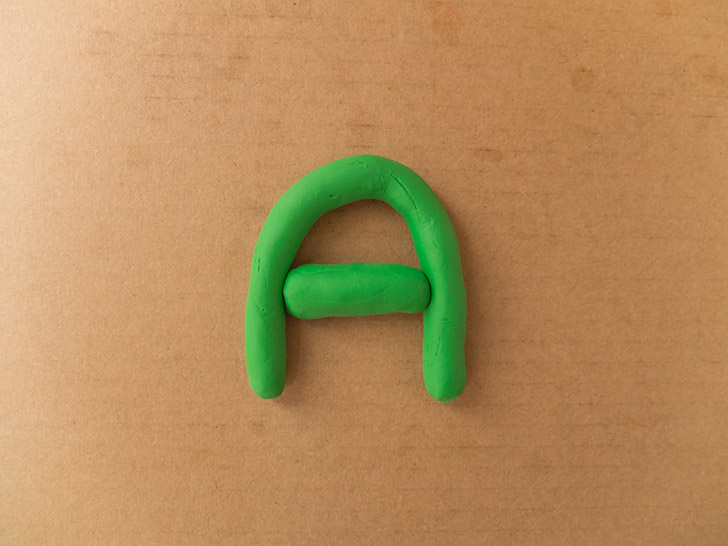 Printing words with play dough.